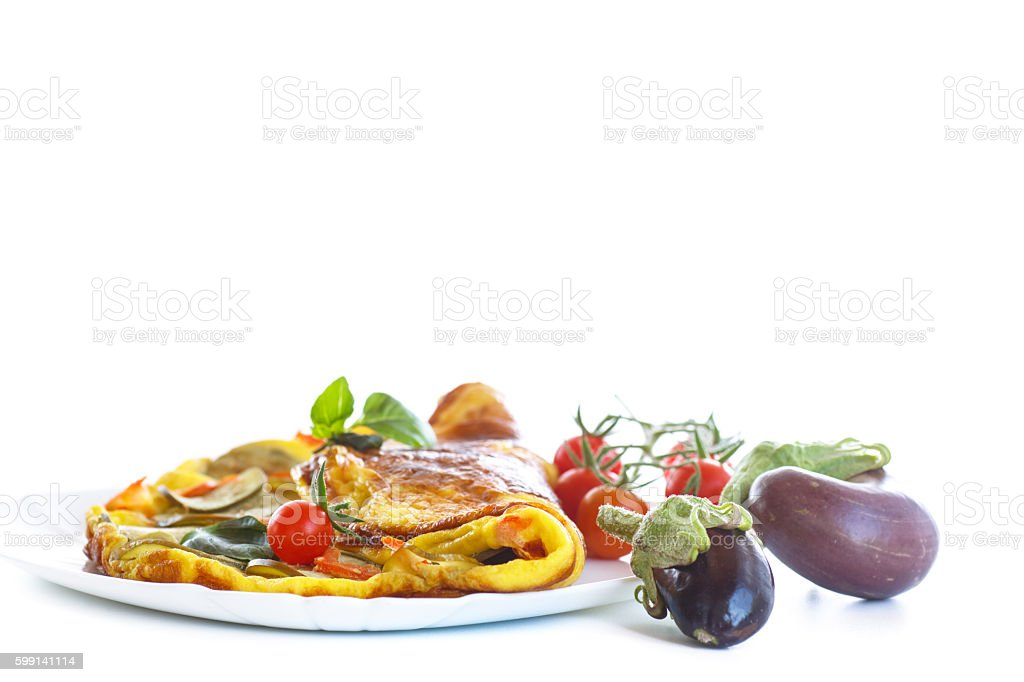 fried omelet with eggplant and tomatoes stock photo