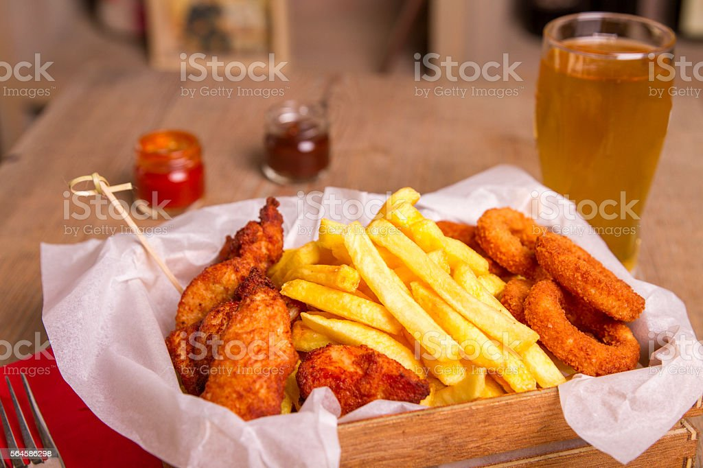 Fried Onion, Chicken, Fish and Chips stock photo