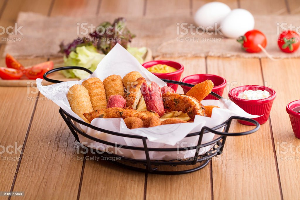 Fried Onion rings, squid, chicken, deep fried potato, sausages stock photo