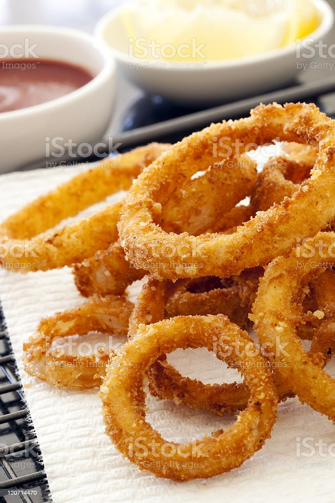 Fried Onion Rings with Ketchup and Lemon stock photo