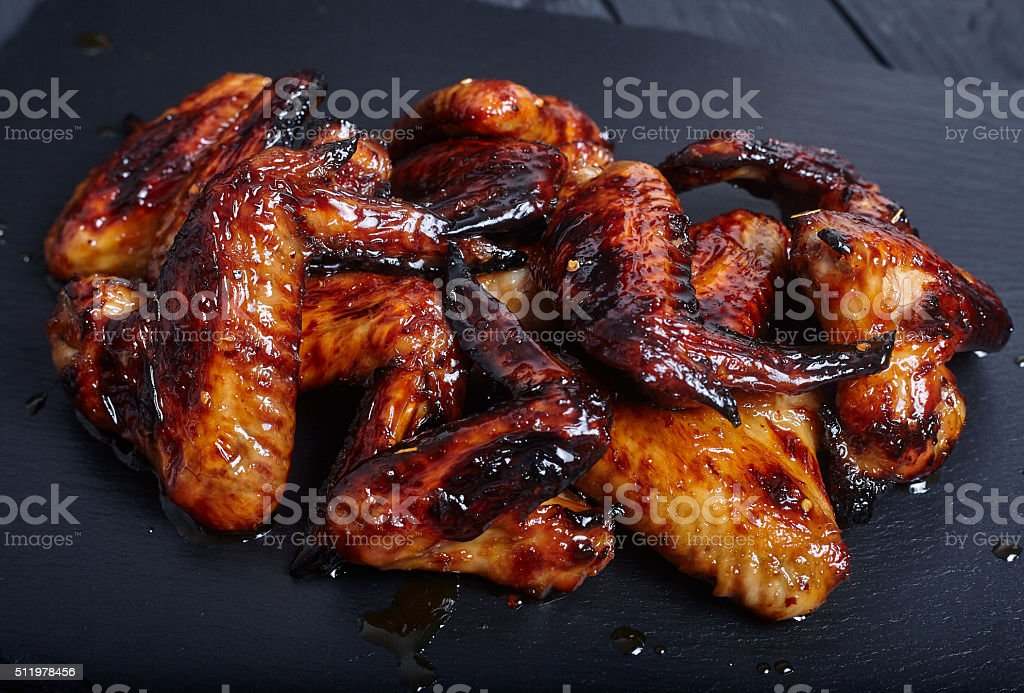 Fried or roasted Chicken Wings stock photo