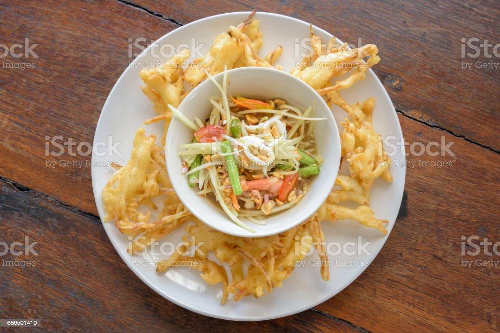 Fried Papaya Salad Recipe (Som Tum Tod) stock photo