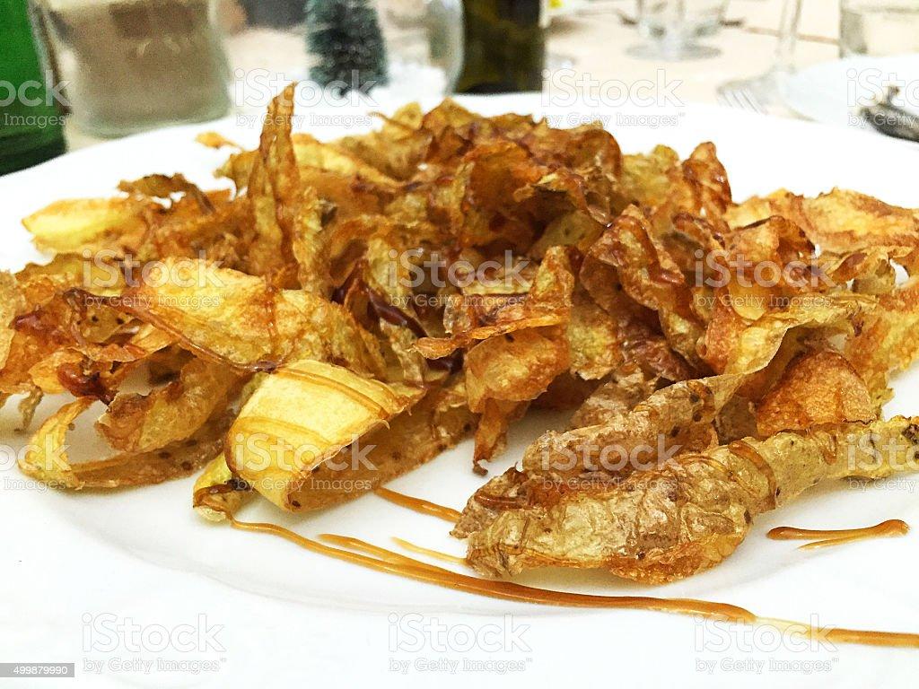 Fried peel potato with teriyaki sauce stock photo