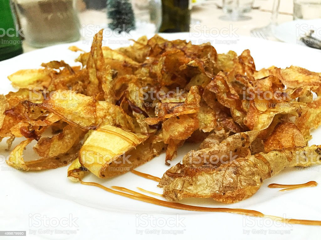 Fried peel potato with teriyaki sauce stock photo