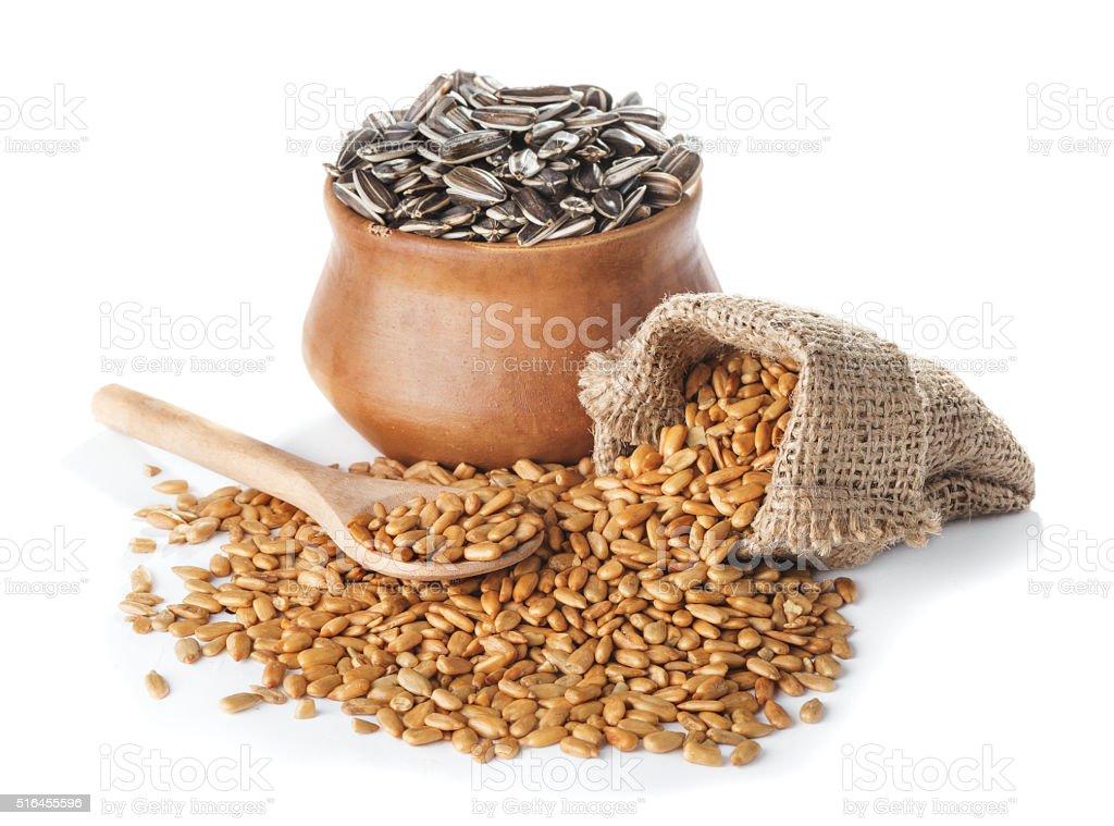 Fried peeled  and  crude sunflower seeds stock photo