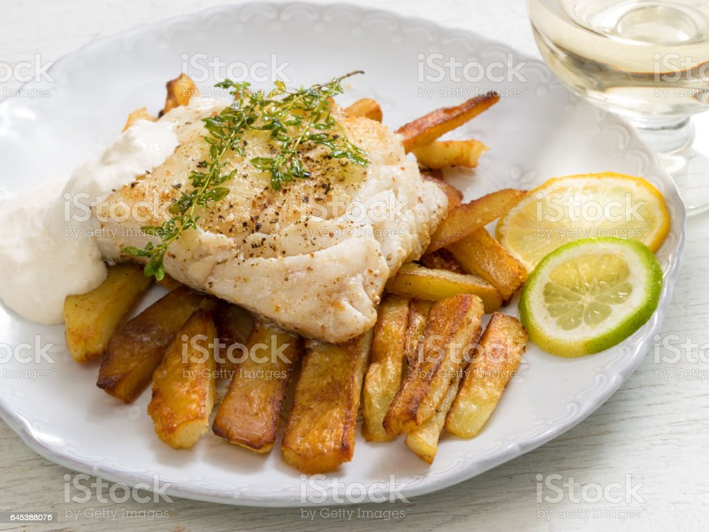 Fried perch with mashed potatoes, lemon and lime slice stock photo
