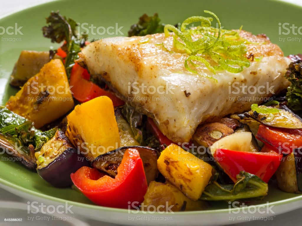 Fried perch with vegetables stock photo