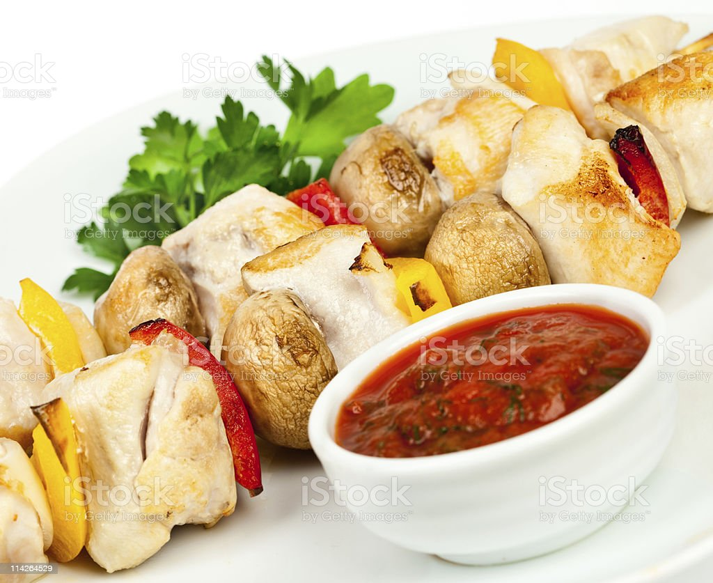 Fried pieces of a hen with sauce royalty-free stock photo