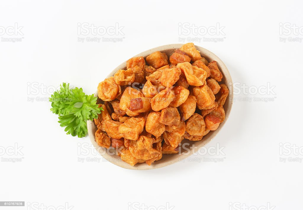 Fried pieces of pork rind and fat stock photo