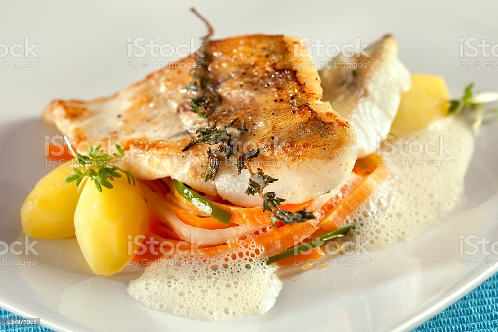 Fried pike perch fillet with vegetables. stock photo
