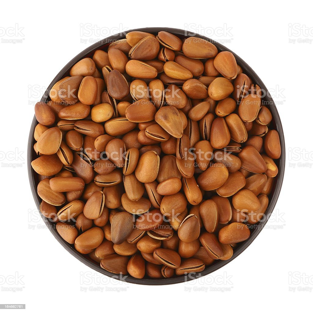 fried pine nut in the bowl stock photo