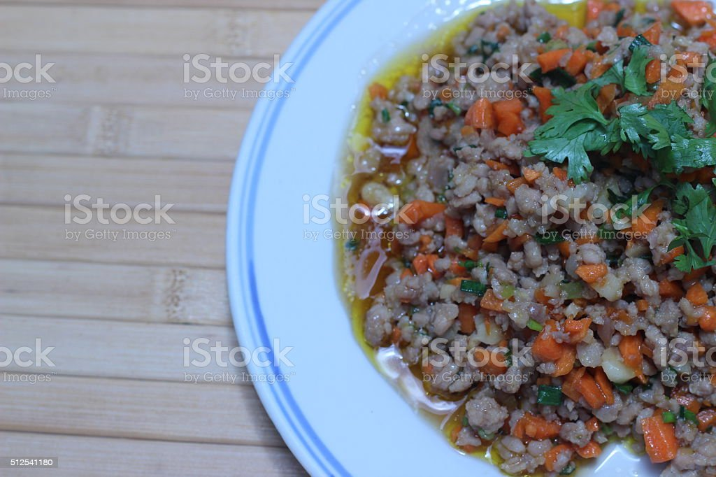 Fried pork chops with carrots on a white plate stock photo