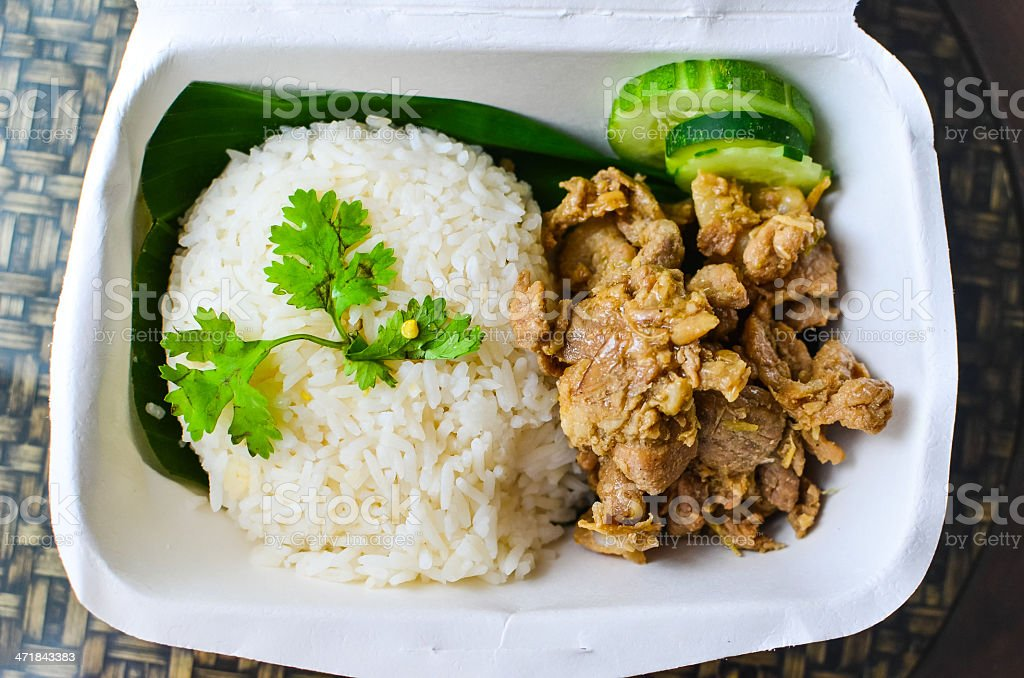 Fried pork with garlic on rice - Thai Street Food royalty-free stock photo