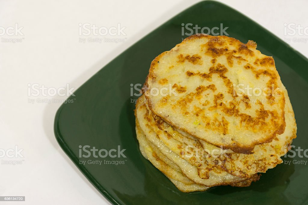 fried potato pancakes, stacked, green ceramic plate, Breakfast; hearty stock photo