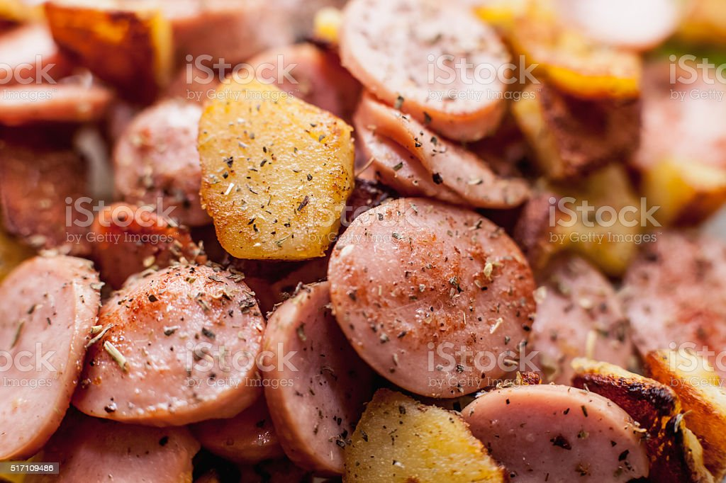 Fried potato with sausages stock photo