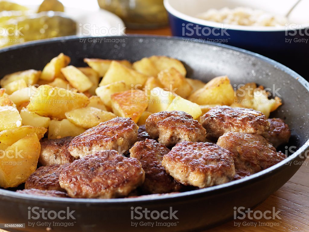 Fried potatoes and meatballs to the pan royalty-free stock photo