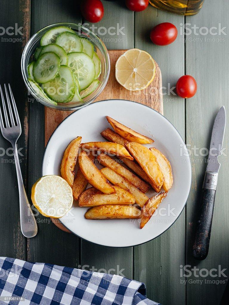 Fried potatoes on plate stock photo