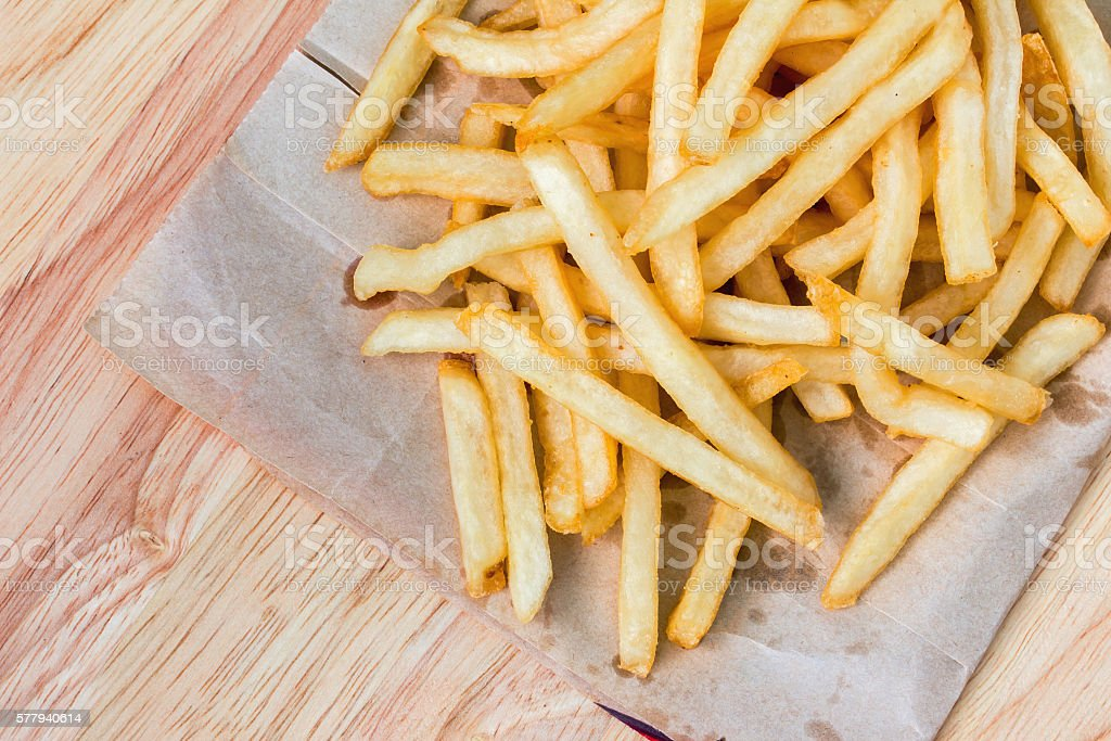 fried potatoes on wood stock photo
