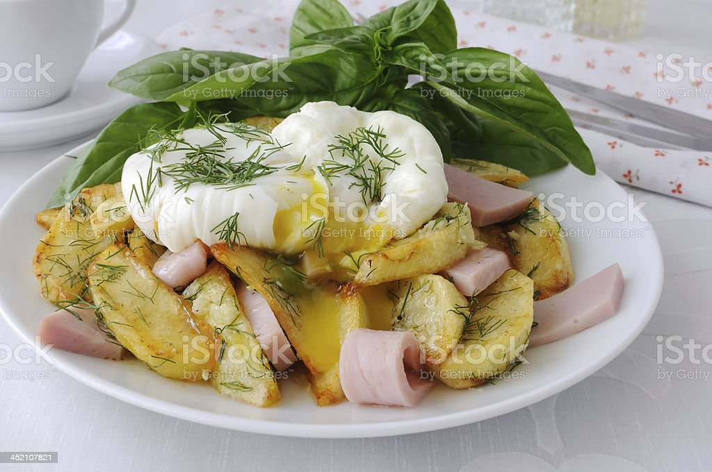 Fried potatoes with dill and ham , eggs Benedict stock photo