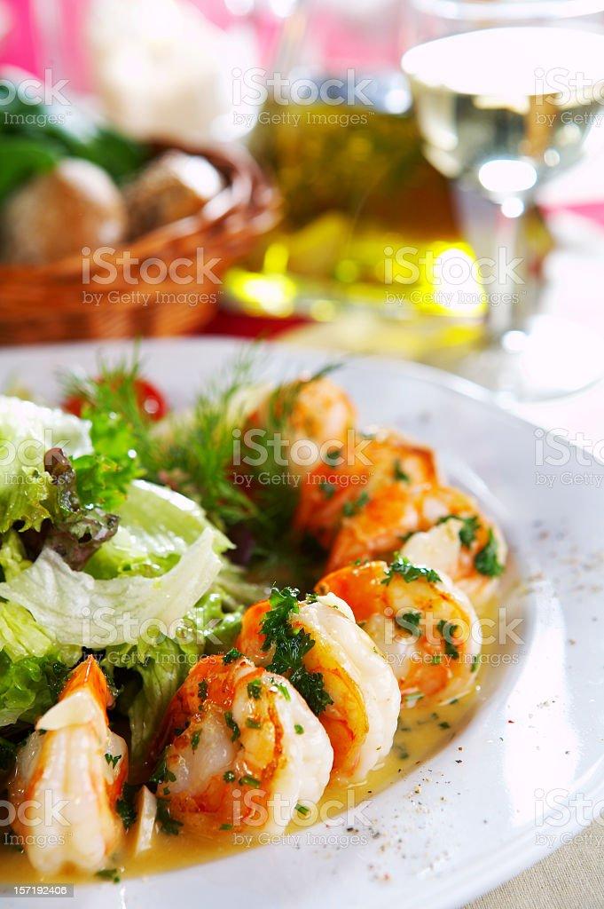 Fried prawns with salad on a white plate royalty-free stock photo