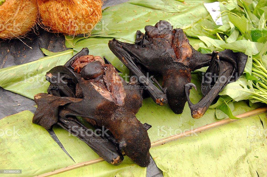 Fried rat at banana leaf stock photo