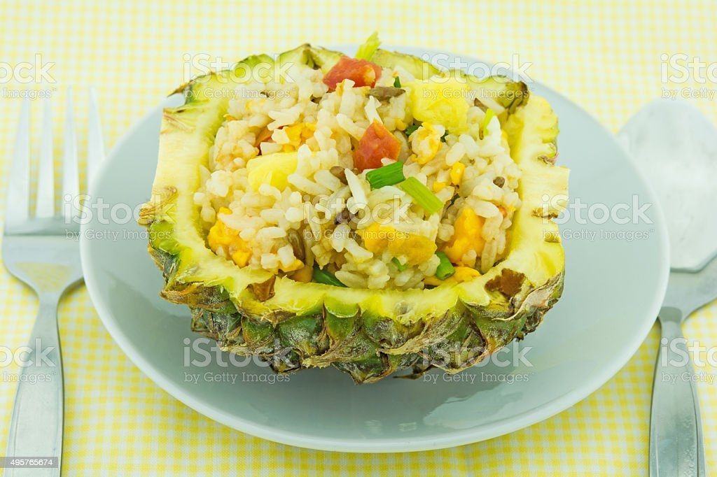 Fried rice in pineapple stock photo