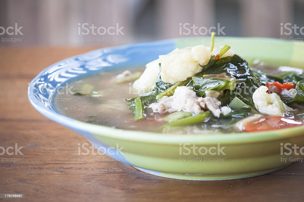 Fried rice noodles topped with pork and vegetable royalty-free stock photo