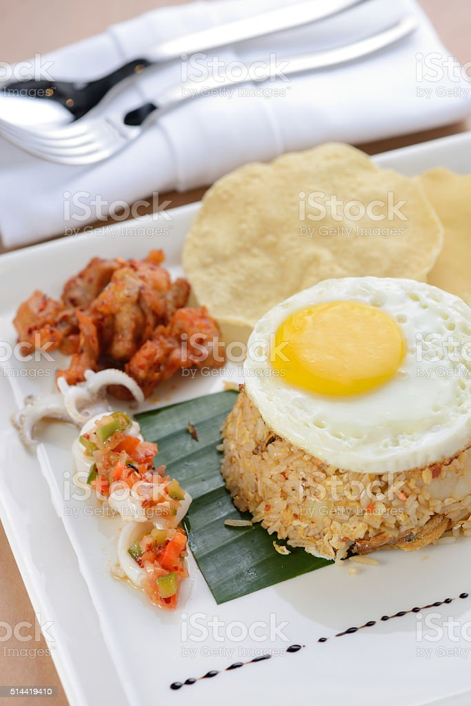 Fried rice with egg, chicken and prawn cracker stock photo