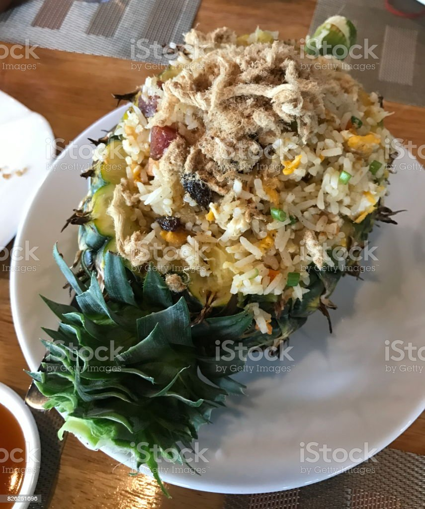 Fried rice with pineapple served in a pineapple. stock photo