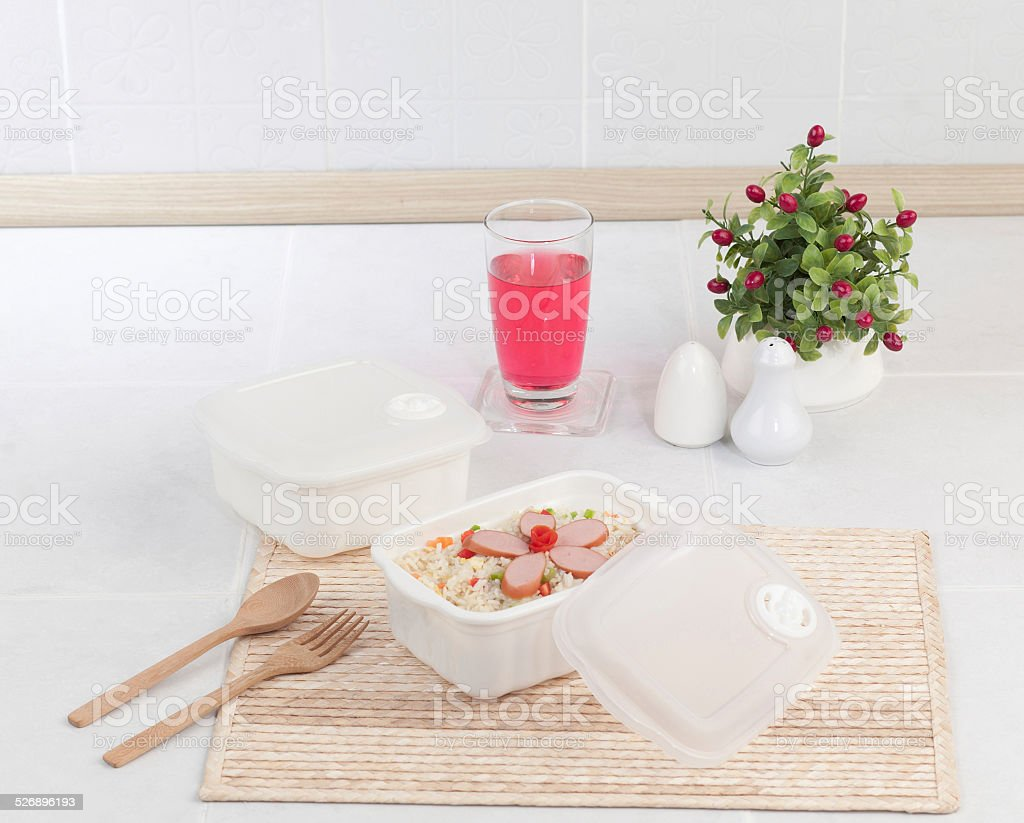 Fried rice with sausages in plastic box stock photo