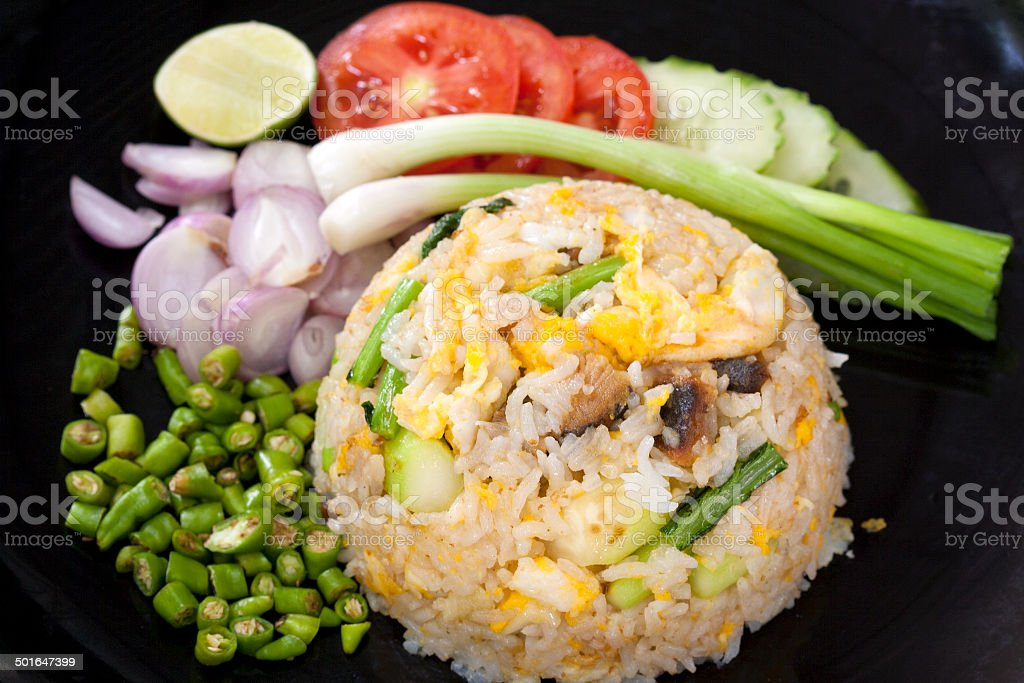 Fried Rice with shrimps serve with fresh vegetable royalty-free stock photo