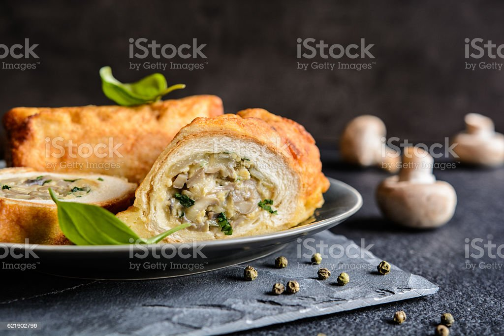 Fried rolls coated in batter, stuffed with mushrooms and cheese stock photo