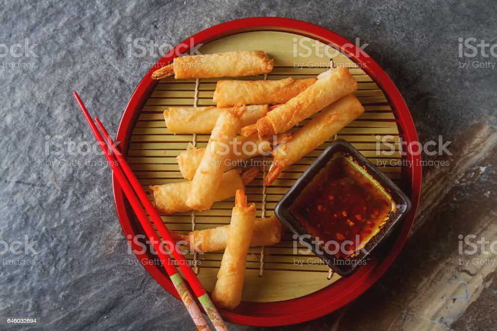 Fried rolls with prawns, served with sweet chili sauce and chops stock photo