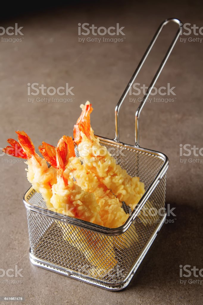 Fried rolls with prawns, served with sweet chili sauce and chopsticks. Dark background. stock photo