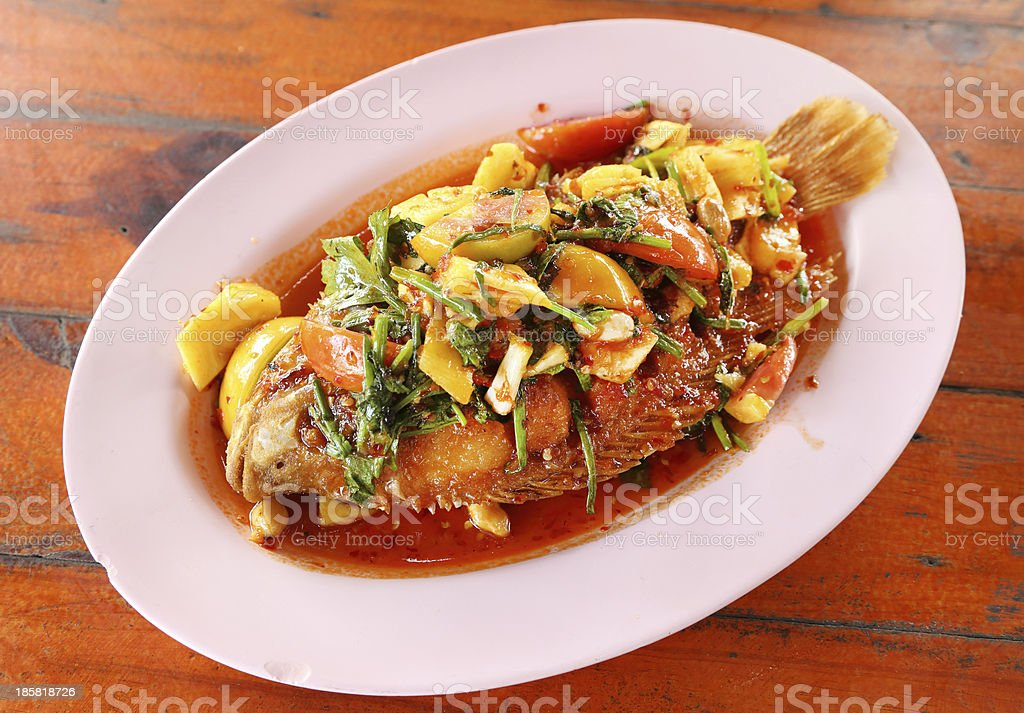 Fried ruby fish topped with sweet,sauer and hot sauce royalty-free stock photo
