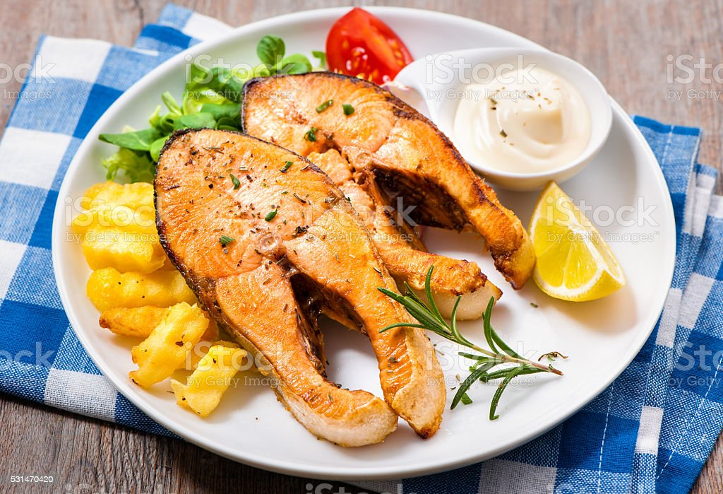 Fried salmon and vegetables stock photo