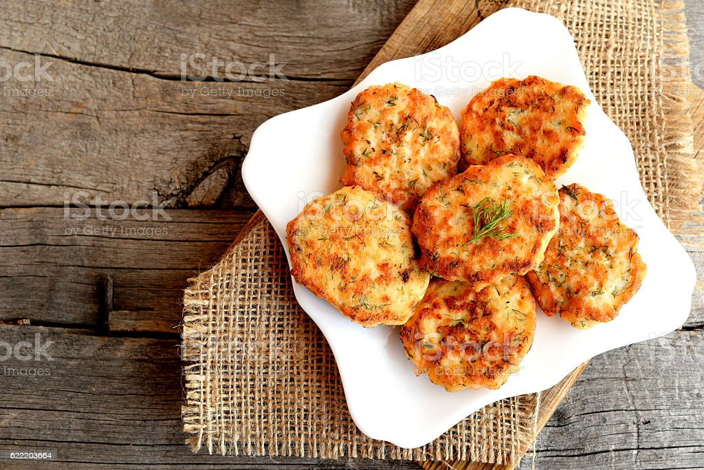 Fried salmon cutlets on a plate stock photo