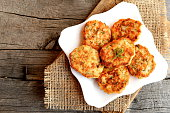 Fried salmon cutlets on a plate