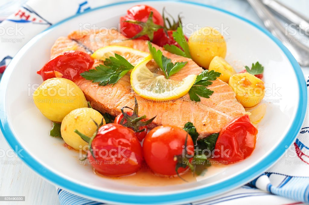Fried Salmon  with vegetables. stock photo
