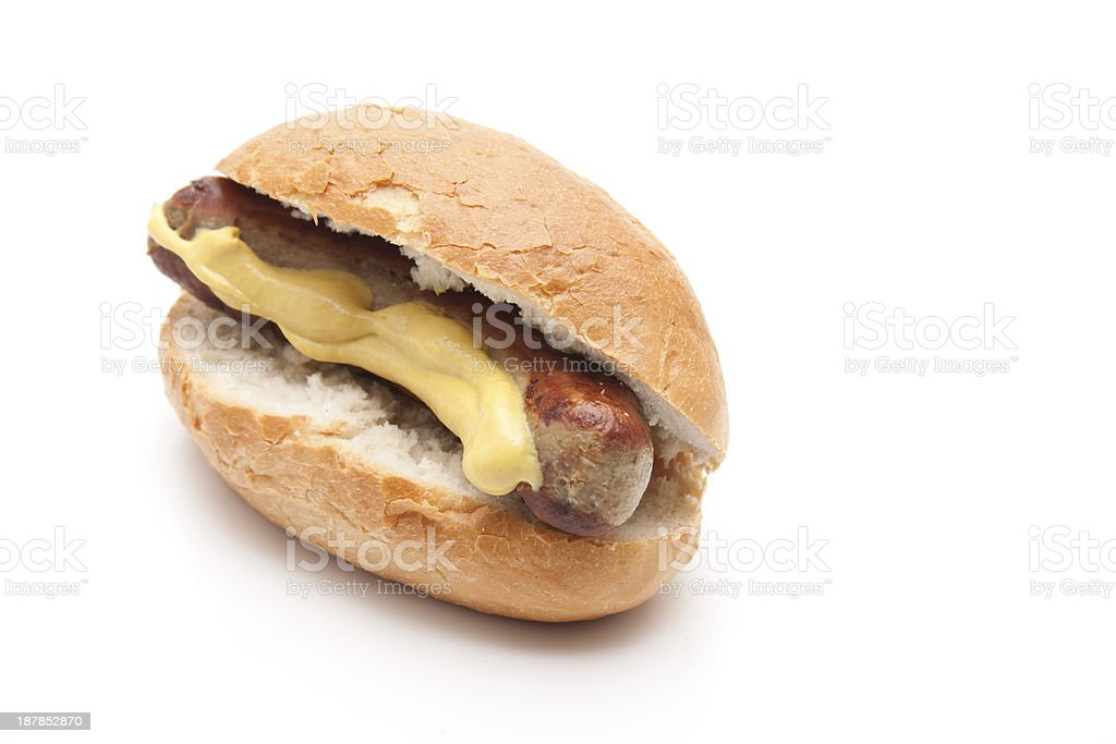Fried sausage with mustard and roll stock photo
