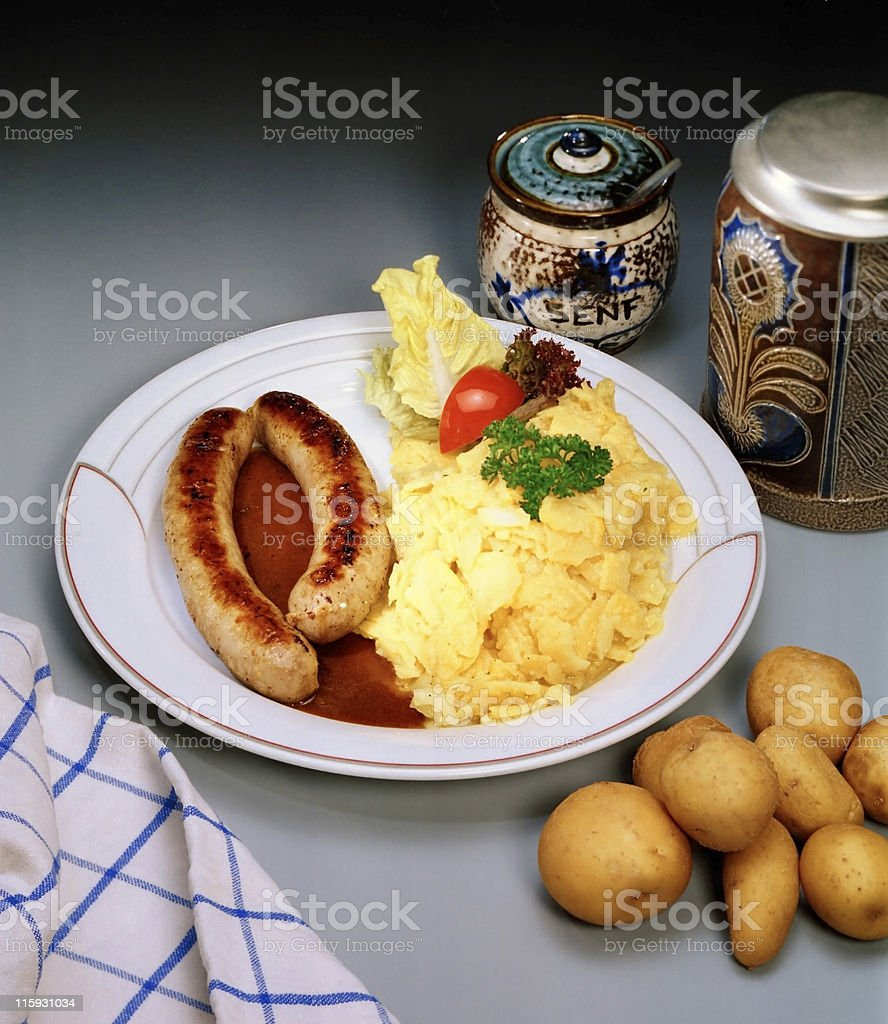 fried sausages and potato salad royalty-free stock photo