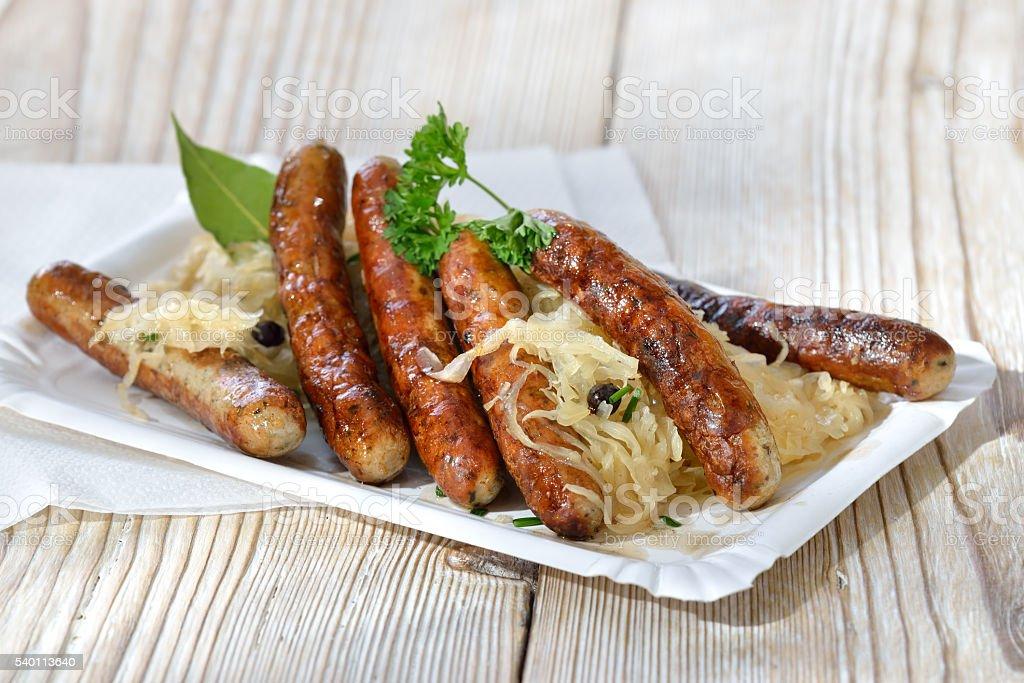 Fried sausages on sauerkraut stock photo