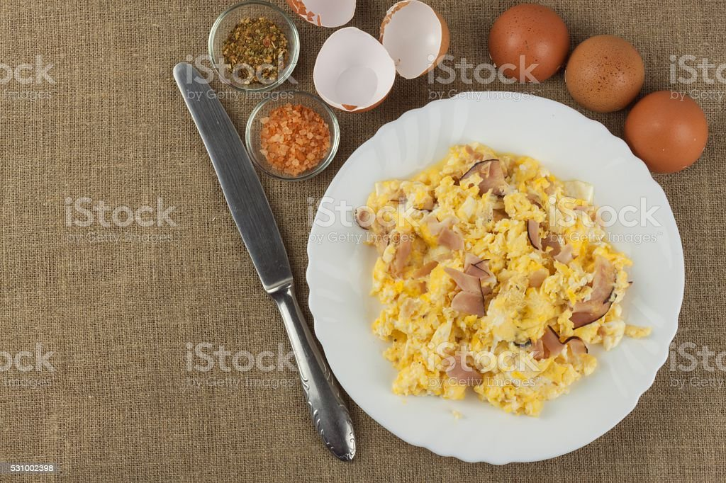 Fried scrambled eggs on a plate. stock photo