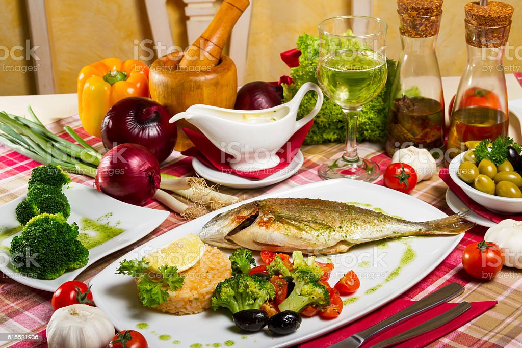 Fried Sea Bream Side Dish Sauce Olive Oil and Wine stock photo