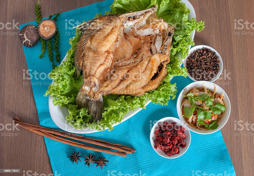 Fried sea perch topped with savory fish sauce menu stock photo