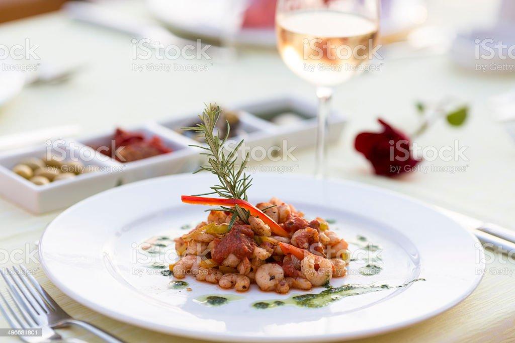 Fried shrimp and white wine stock photo