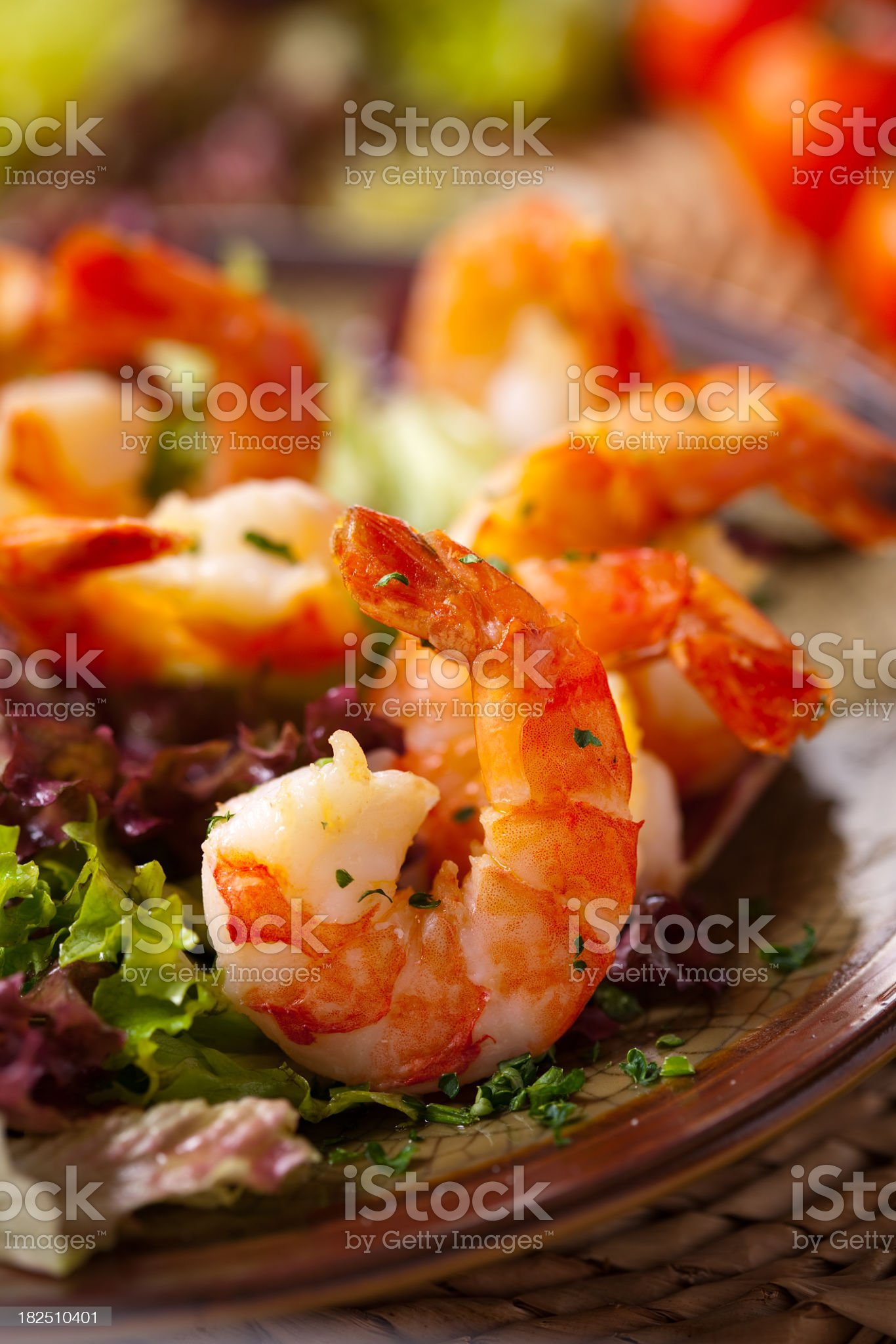 Fried shrimp salad on a brown plate royalty-free stock photo