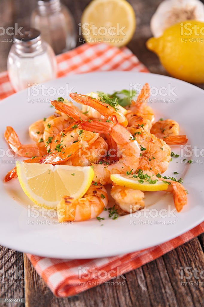 fried shrimp with herbs stock photo