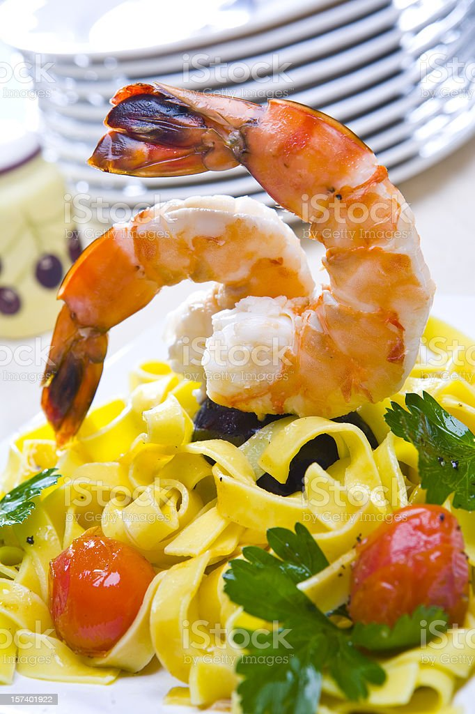 Fried shrimp with tagliatelle royalty-free stock photo