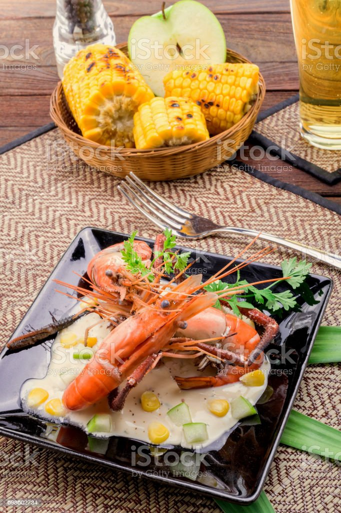Fried shrimps Apple Sauce with glass of beer stock photo